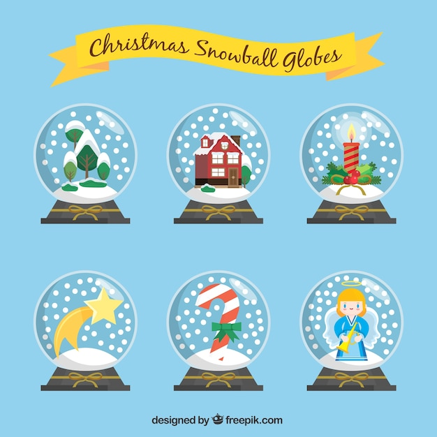 Various snowglobes with nice christmas elements Free Vector