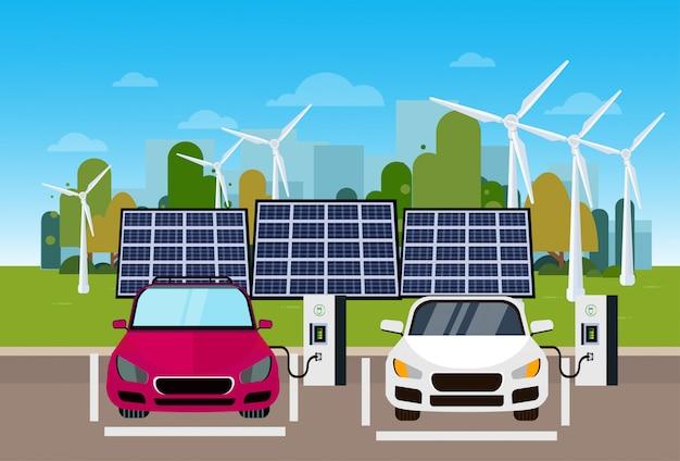Зарядка электромобилей на станции от ветровых турбин и солнечных батарей экологичная концепция vechicle Premium векторы