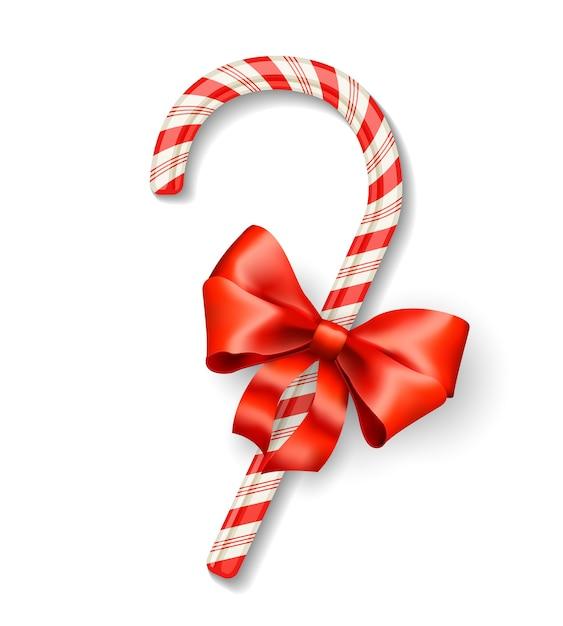 白で隔離の赤い弓とベクトルクリスマスキャンディケイン 無料ベクター