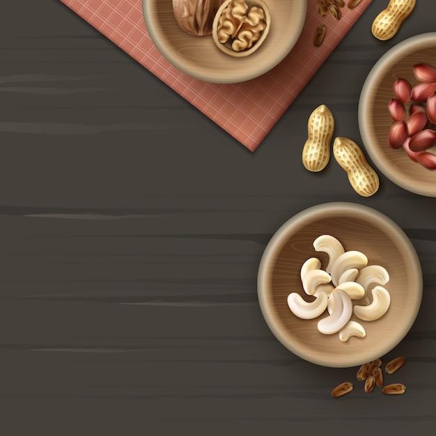 Вектор различных орехов в деревянных мисках, арахис, кешью и грецкие орехи вид сверху на темно-черной поверхности с клетчатой салфеткой Premium векторы