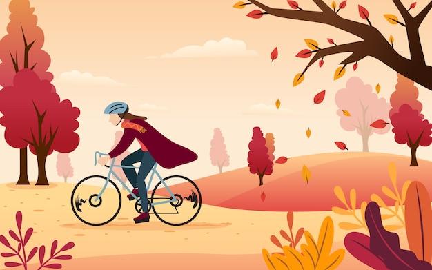 바람과 함께 공원 주변에서 자전거를 타면서 쾌적한 가을을 즐기는 것에 대한 평면 디자인을위한 벡터 영감. 프리미엄 벡터