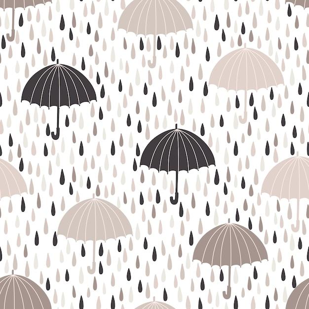 雨滴と傘とシームレスなパターンベクトル。春の背景 Premiumベクター
