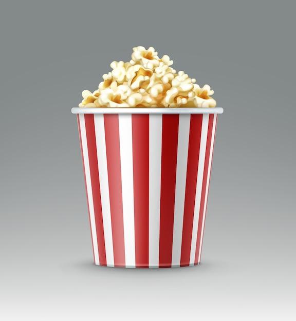Вектор бело-красное полосатое ведро ядер попкорна крупным планом, вид сбоку, изолированные на сером фоне Бесплатные векторы