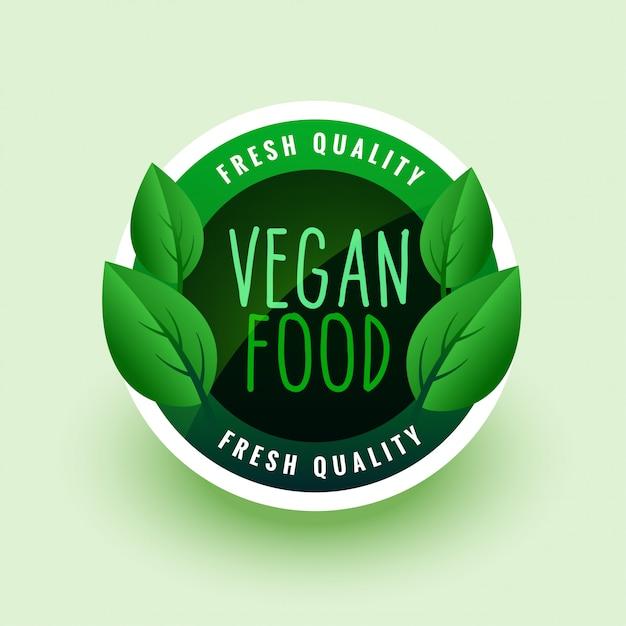 Vegan food green leaves label or sticker Free Vector