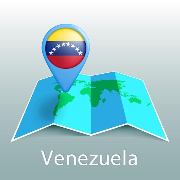 Карта мира флаг венесуэлы в булавке с названием страны на сером фоне Premium векторы