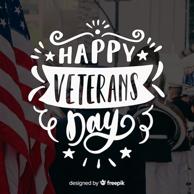 Veterans day lettering with stars and ribbons Free Vector