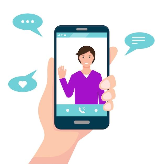 ビデオ通話またはコミュニケーションアプリのコンセプト。画面上の男と人間の手はスマートフォンを保持します。 Premiumベクター