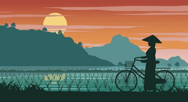 Vietnamese woman hold bicycle walk Premium Vector