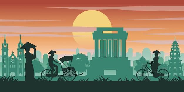 Vietnamese woman and man ride bicycle pass landmark Premium Vector