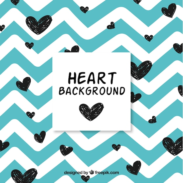 Vintage background with hand drawn hearts Free Vector
