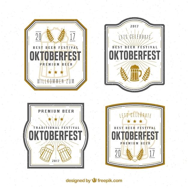 Distintivi vintage con birra e frumento Vettore gratuito
