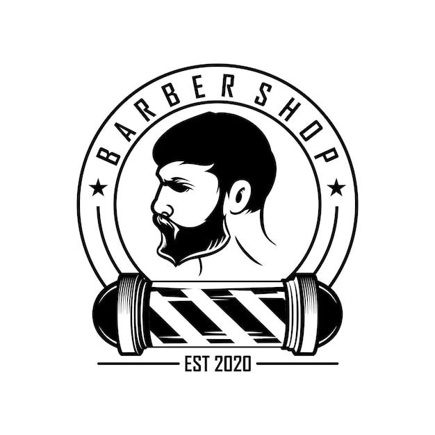 ヴィンテージ理髪店のロゴ Premiumベクター