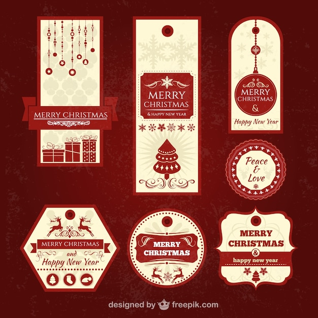 Vintage christmas tags Free Vector