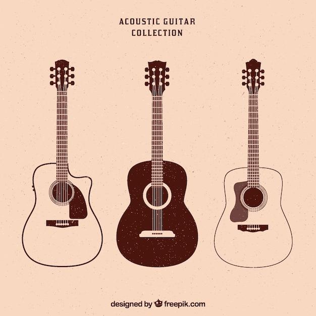 Винтажная коллекция из трех акустических гитар Premium векторы