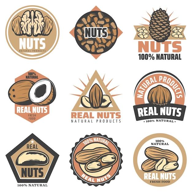 Винтажные цветные эмблемы органических продуктов питания с надписями и различными вкусными натуральными орехами изолированы Бесплатные векторы
