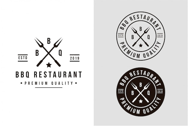 Vintage grill barbeque logo with crossed bbq fork Premium Vector