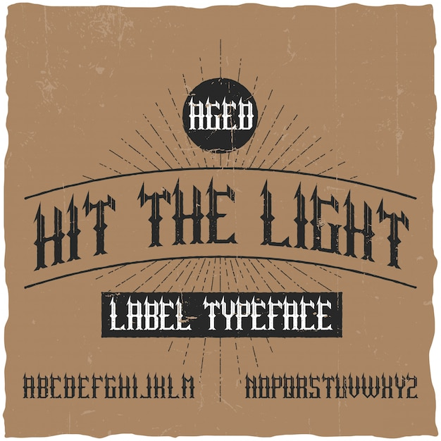Vintage label typeface named hit the light. good font to use in any vintage labels or logo. Free Vector