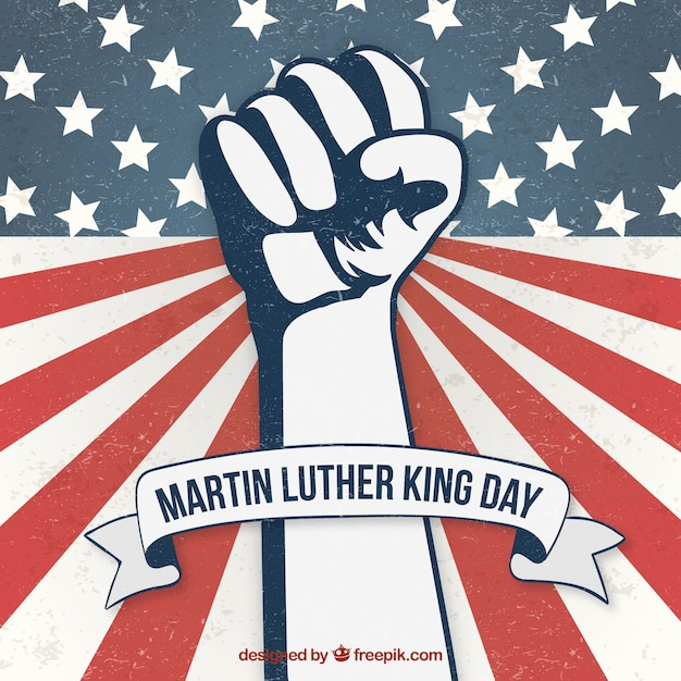 Vintage martin luther king day fist background Free Vector