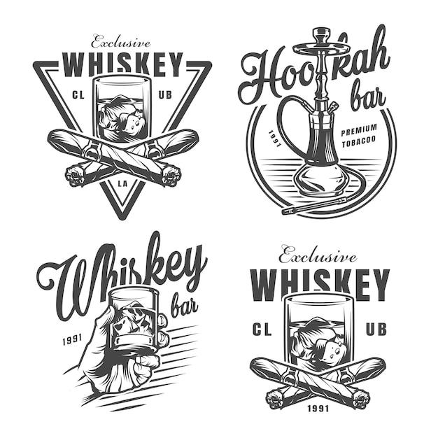 Vintage monochrome whiskey bar emblems Free Vector