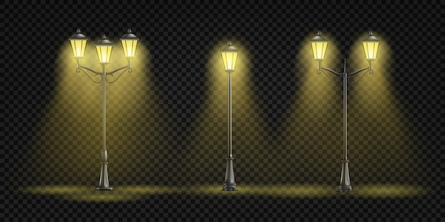 Vintage street lights glowing with yellow light Free Vector