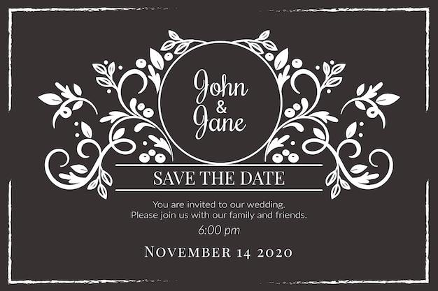 Vintage wedding invitation template on blackboard Premium Vector