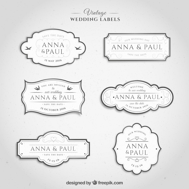 Vintage wedding labels in white color Premium Vector