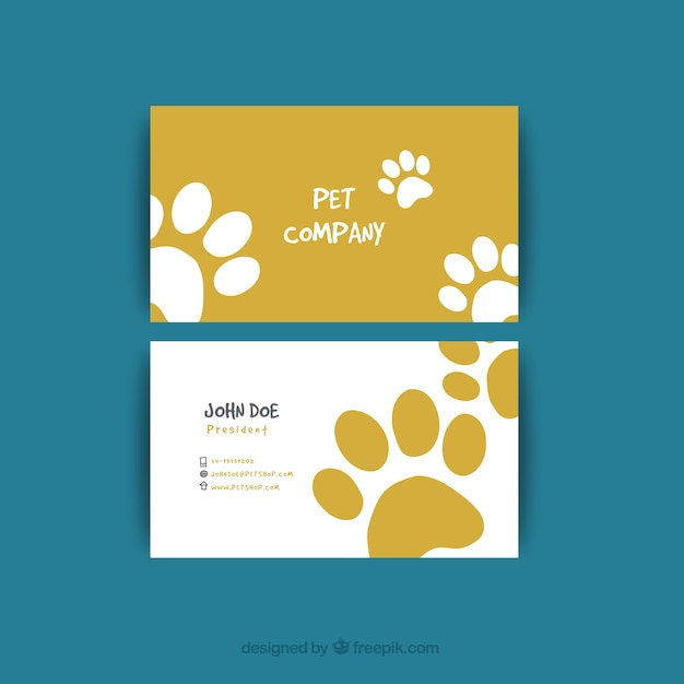 Visiting card with tracks for pet shop Free Vector
