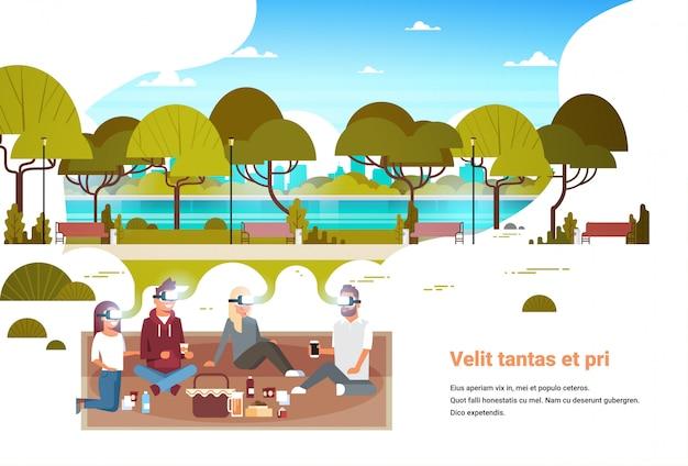 人々のグループは、都市都市公園バーチャルリアリティvrビジョンヘッドセット革新コンセプトでピクニックを持つデジタルメガネを着用します。 Premiumベクター