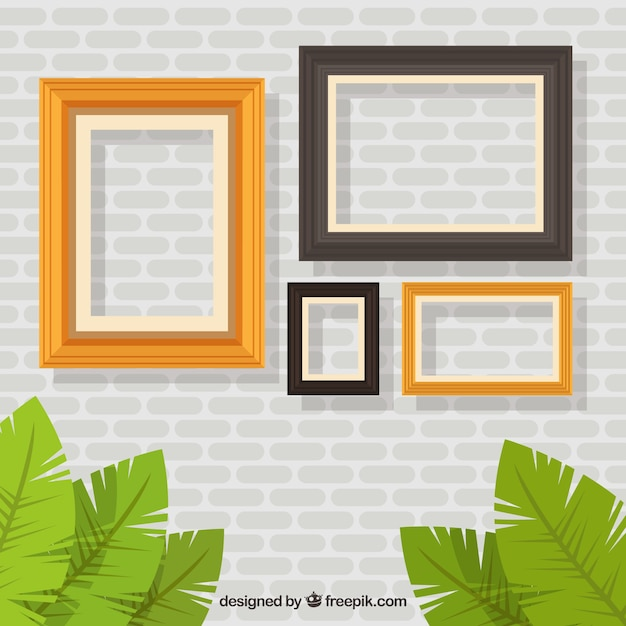 Wall with frames of different sizes Vector | Free Download