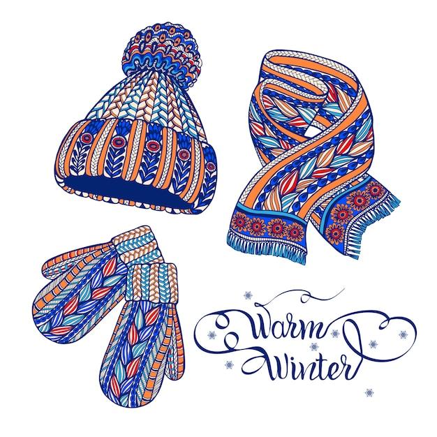 Doodle di sciarpa guanti caldi cappello Vettore gratuito