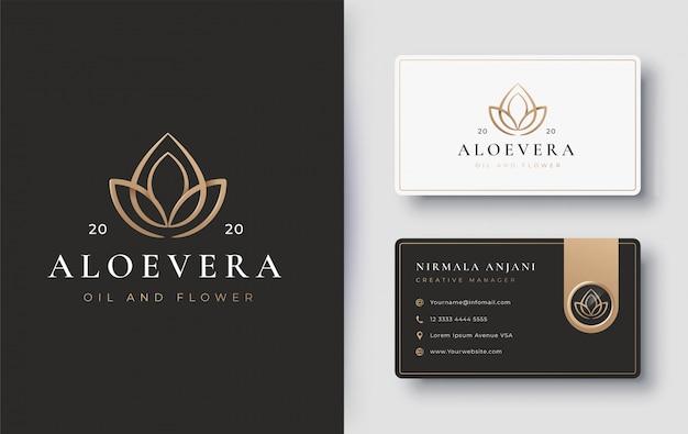 Water drop oil with lotus flower logo design Premium Vector
