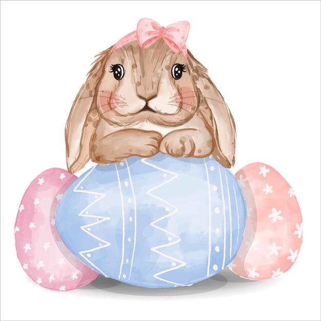 Coniglietto dell'acquerello con uova rosa e blu Vettore gratuito