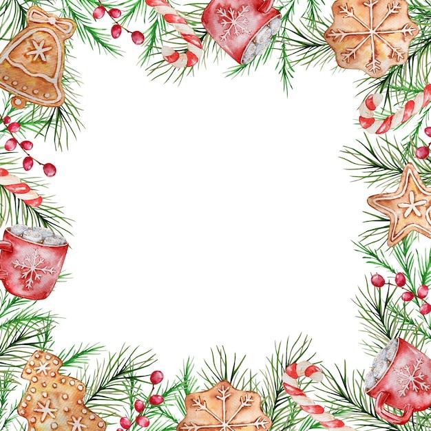 冬のトウヒと松の枝、ベリー、赤いマグカップ、お菓子、ジンジャーブレッドの水彩画のクリスマスフレーム。 Premiumベクター