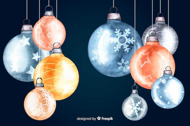 Watercolour christmas balls on dark background Free Vector