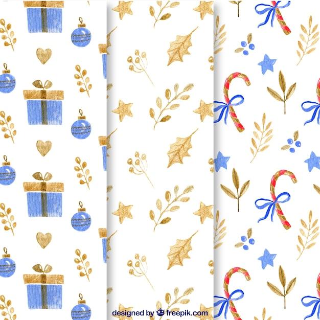 Watercolour christmas patterns set Free Vector