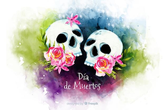 Watercolour dia de muertos couple of skulls background Free Vector