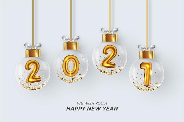 私たちはあなたに現実的なクリスマスボールの白い背景を持つ幸せな年賀状を願っています 無料ベクター