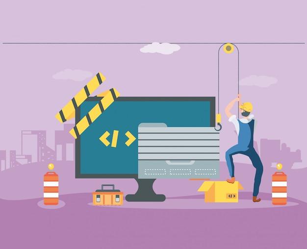 建設中のwebページを持つビルダーとデスクトップ Premiumベクター