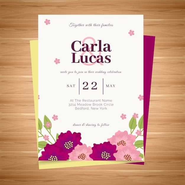 Wedding card with flowers Premium Vector