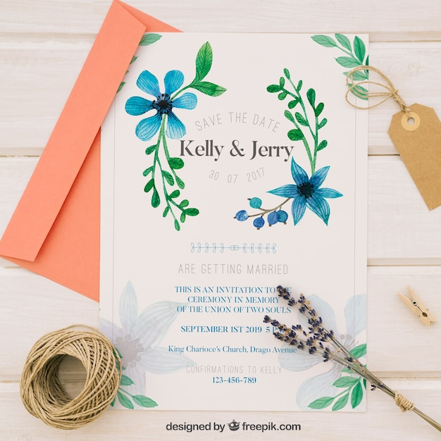 Wedding invitation with blue watercolor flowers