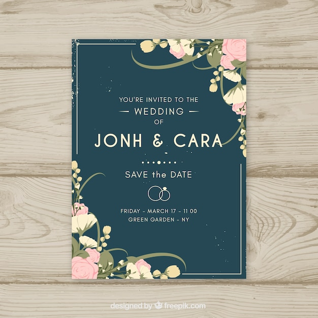 Wedding invitation with hand drawn flowers Free Vector