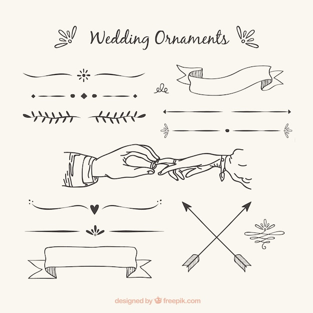 Wedding ornaments with hand drawn style Free Vector