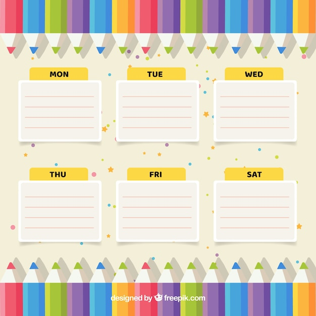 Weekly planner with colorful pencils
