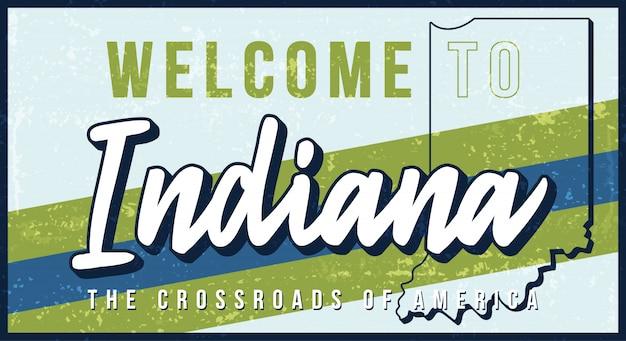 インディアナヴィンテージさびた金属サインイラストへようこそ。タイポグラフィ手描きのレタリングとグランジスタイルの州地図。 Premiumベクター