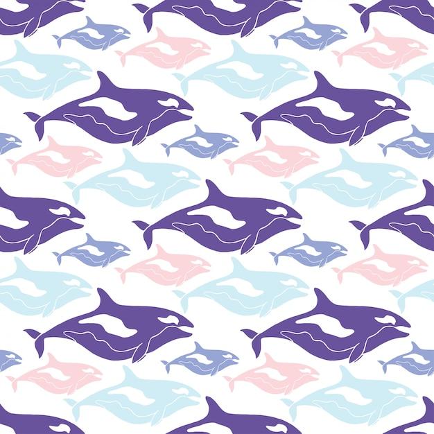 Бесшовный узор китов в синий, розовый и фиолетовый цвета. Premium векторы