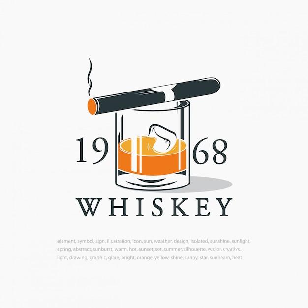 Виски с кубиками льда и сигарой. логотип Premium векторы