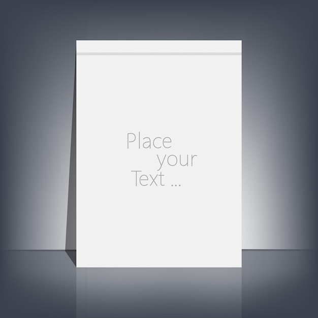 White blank stationary near the black wall with shadow. Premium Vector