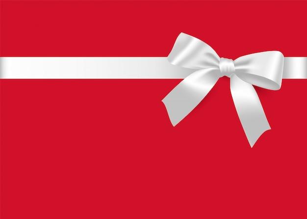 White bow and satin ribbon. Premium Vector