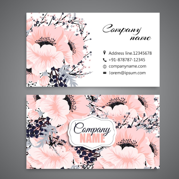 White business card with beautiful flowers Free Vector