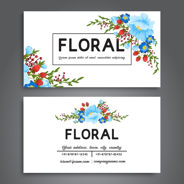 White business card with blue flowers